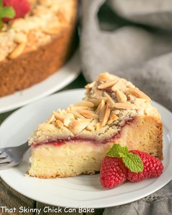 Raspberry Cream Cheese Coffeecake slice on a small white plate