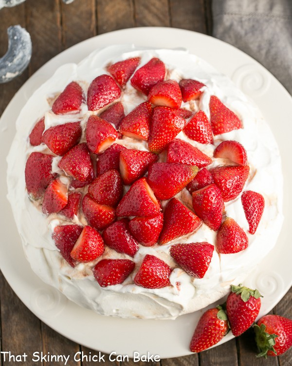 "Strawberry Pavlova | A large ""squidgy"" meringue shell topped with a pillow of whipped cream and balsamic strawberries"
