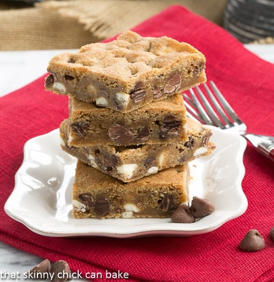 Chippy Bars AKA - Chocolate Chip Cookie Bars stacked on a white square plate under a red napkin