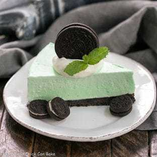 Frozen Grasshopper Pie with an Oreo Crust - Mint lovers will swoon with every bite of this frozen dessert!