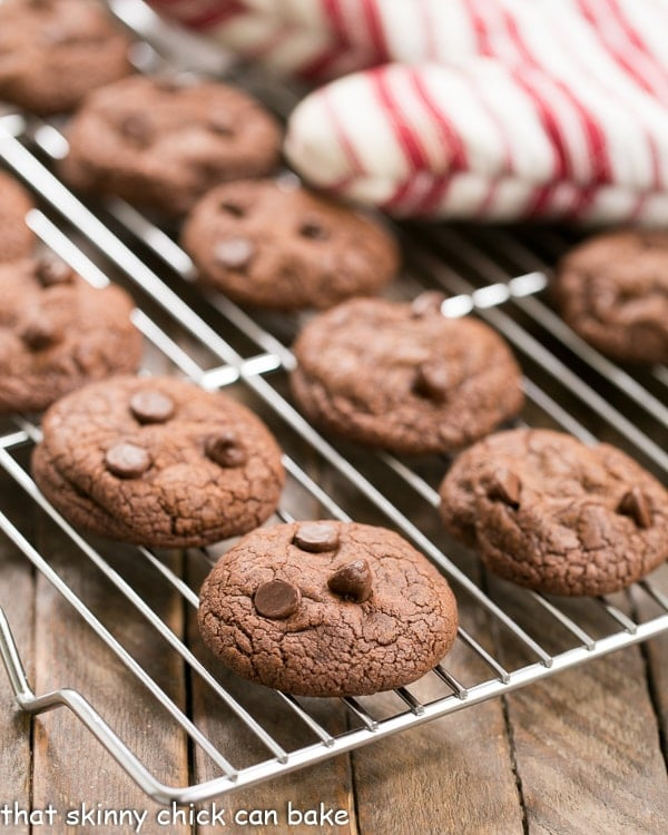 Triple Chocolate Cookies on a cooling rack with a red and white striped oven mitt