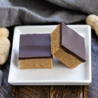 Better Than Reese's Peanut Butter Bars stacked on a small square white plate