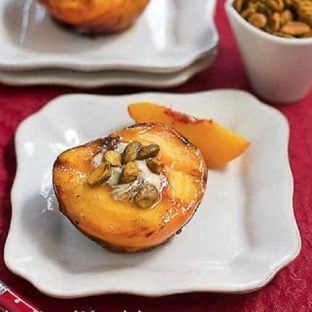 Grilled Peaches with White Chocolate on a square white plate