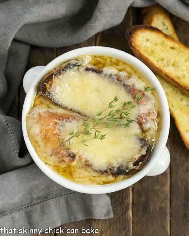 Classic French Onion Soup topped with two slices of cheesy toasts