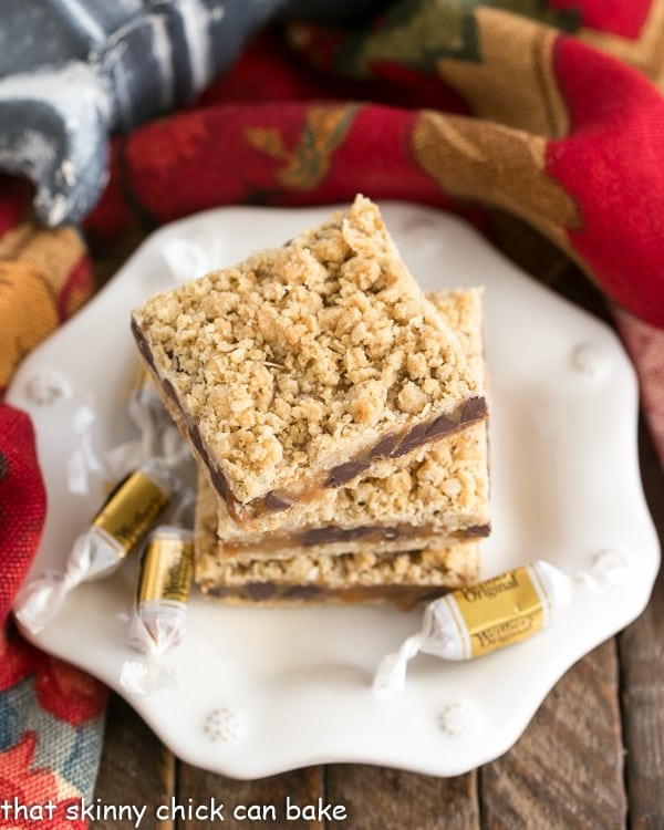 overhead image of Oatmeal Caramel Bars stacked onto a dessert plate