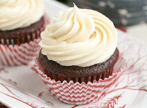 Red Velvet Cupcakes   The quintessential red velvet cupcakes made with buttermilk and a splash of of vinegar. The cream cheese icing is also to die for!!