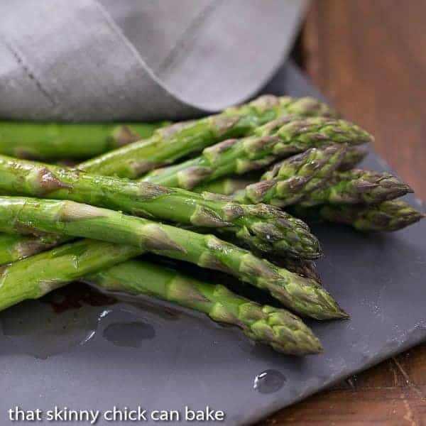Roasted Asparagus with Balsamic Brown Butter on a slate serving platter