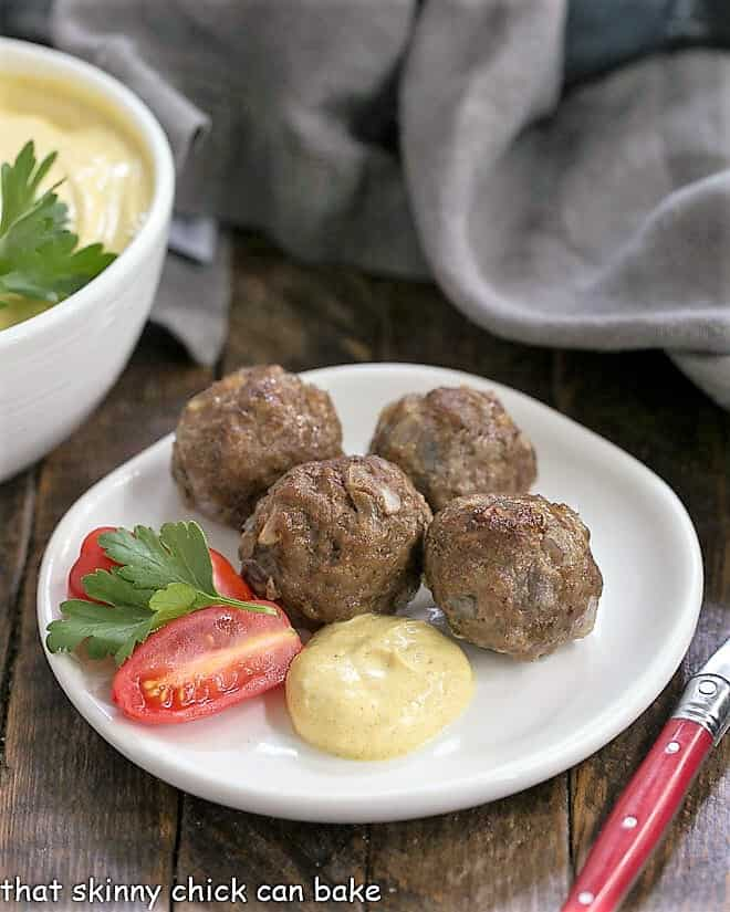 Indian Meatballs with Yogurt Sauce on a white appetizer plate