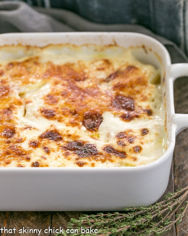 French Potato Gratin | A exquisite creamy potato casserole kissed with garlic, thyme and topped with Gruyere cheese!