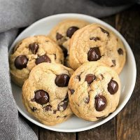Killer Chocolate Chip Cookies arranged on a round white plate