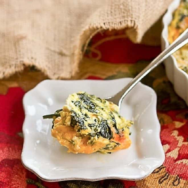 A spoonful of Spinach Souffle on a small white plate