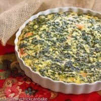 Spinach Souffle in a white casserole dish