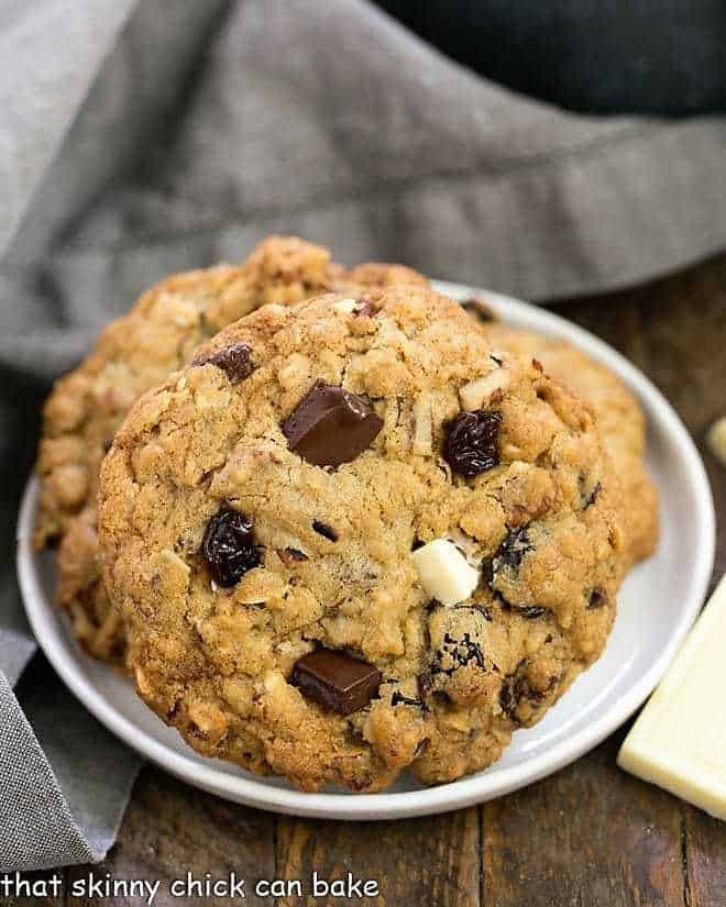 Oatmeal Cookies with Chocolate Chunks, Pecans, and Dried Cherries on a white dessert plate