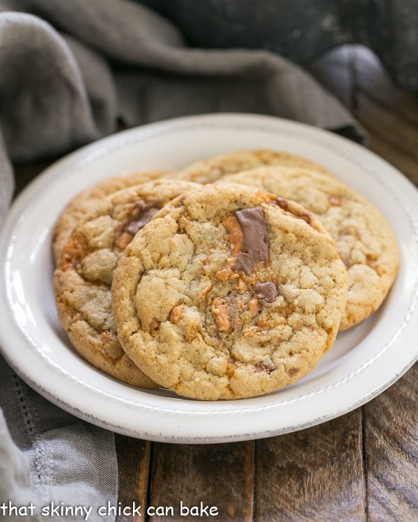Chewy Butterfinger Cookies arranged on a round white plate