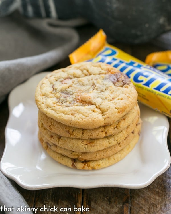 Chewy Butterfinger Cookies stacked on a white plate
