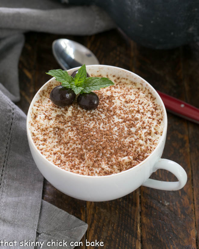 chocolate tiramisu in a tea cup garnished with chocolate espresso beans