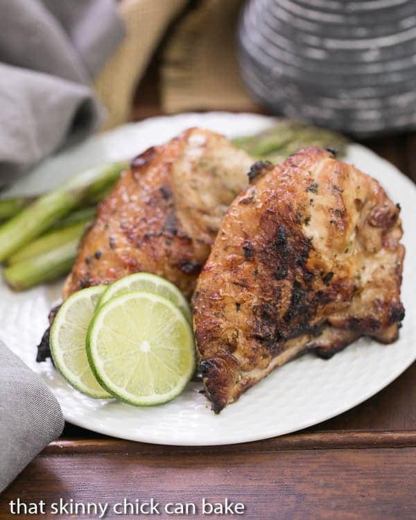 Grilled Thai Chicken   Marinated in coconut milk with fish sauce, lime juice, garlic and cilantro, this is one of the BEST grilled chicken dishes you'll ever taste!