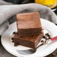Kahlua brownies on a white plate with a red handled fork