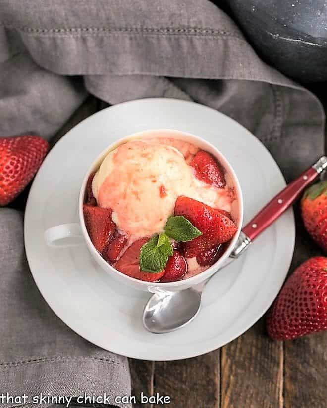 Cheesecake Ice Cream with Strawberry Sauce in a teacup viewed from above