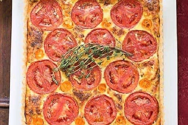 Tomato Gruyere Tart on a square white platter