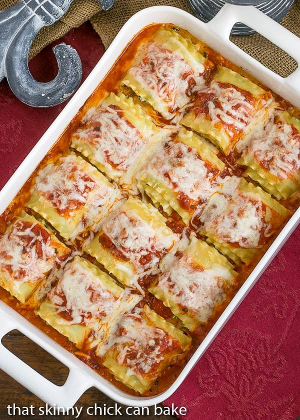 Lasagna Rolls in a white ceramic casserole on a red napkin
