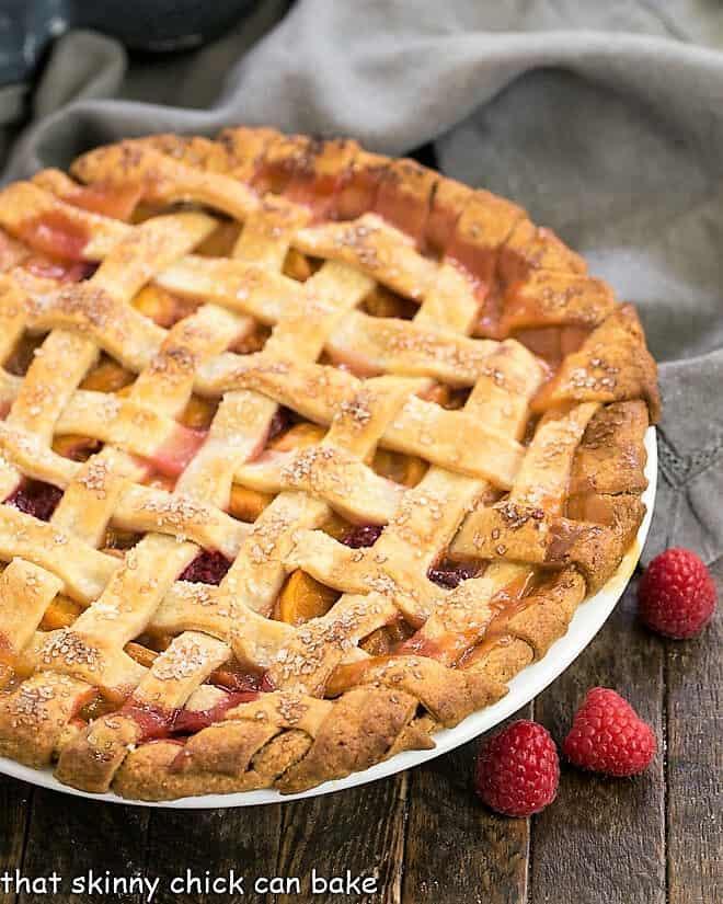 Peach Raspberry Pie in a white pie plate