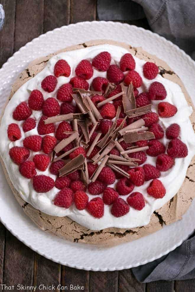Overhead view of Chocolate Raspberry Pavlova on a white ceramic plate