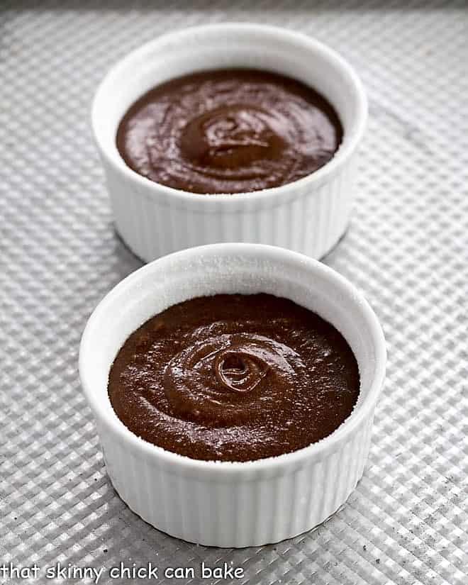 Chocolate lava cake batter in ramekins