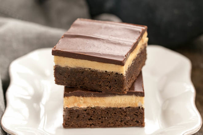 Stack of Peanut Butter Truffle Brownies on a white dessert plate