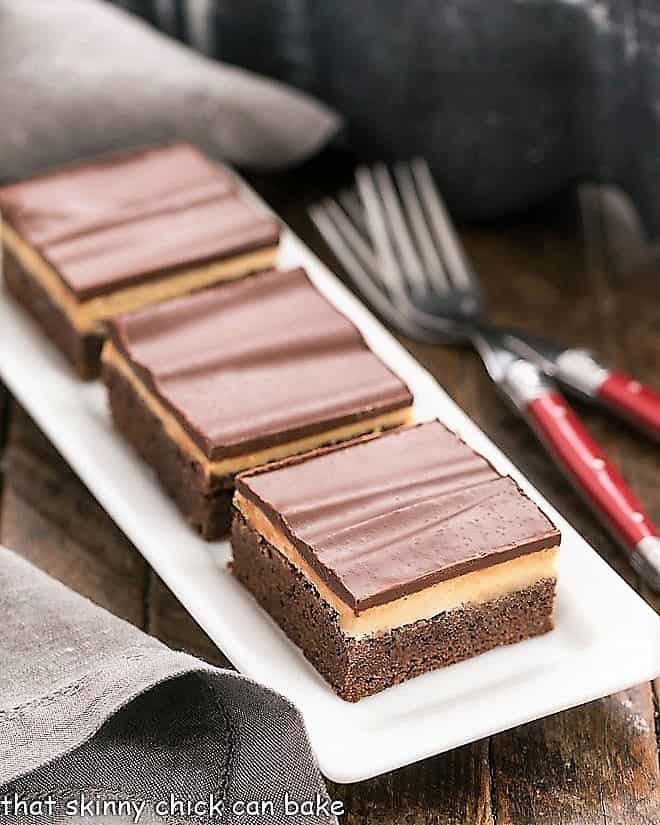 Peanut Butter Truffle Brownies on a white ceramic tray