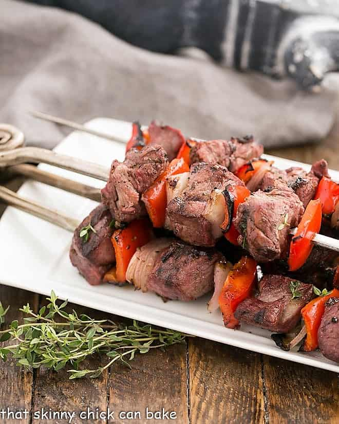 Greek Marinated Lamb Kebabs on a white serving tray