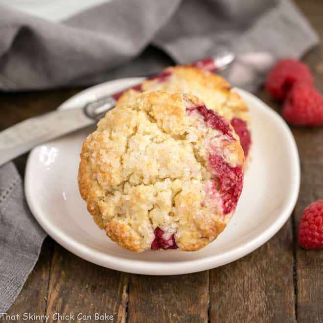 Raspberry Cream Scones on a white plate with a red handled knife