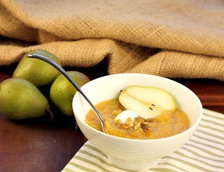 Spiced Squash, Fennel and Pear Soup in a soup bowl with a spoon