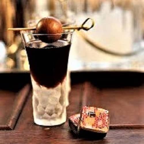 Frangelico Truffle Cocktail garnished with a chocolate truffle