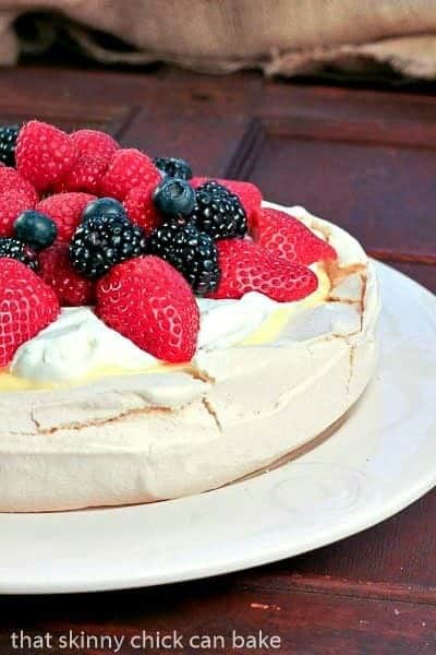 Pavlova with Lemon Curd  on a white serving plate