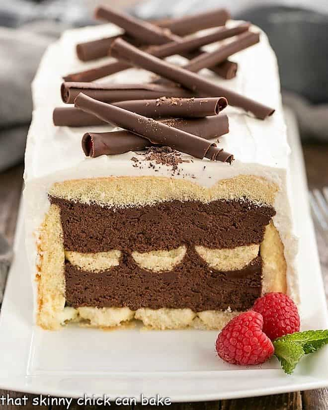 Layered Chocolate Mousse Cake with Ladyfingers---front view with first slice removed