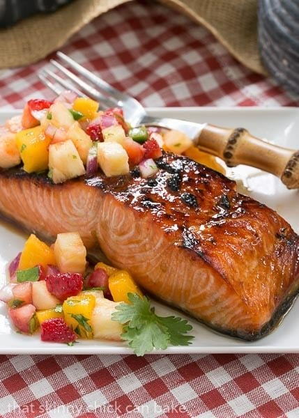 Maple Glazed Salmon on a square white plate on a red and white checked napkin