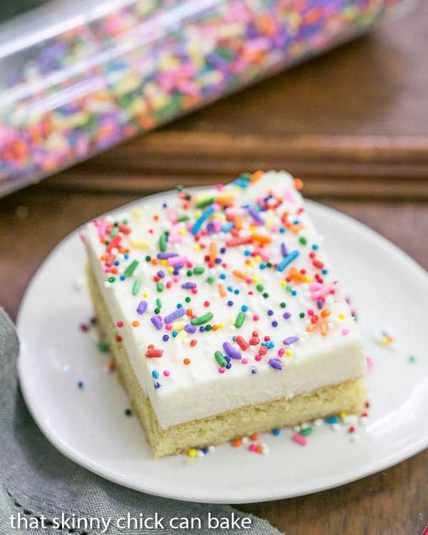 Frosted Sugar Cookie Bars | A sugar cookie base topped with a thick layer of vanilla buttercream and sprinkles!