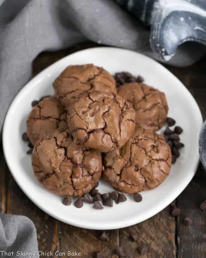 Chocolate Brownie Cookies with Mini Chocolate Chips on a white plate garnished with mini chocolate chips