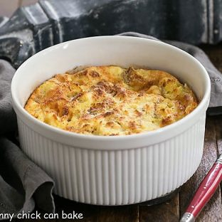 Cheese Souffle AKA Omelet i a souffle dish with a red handle spoon