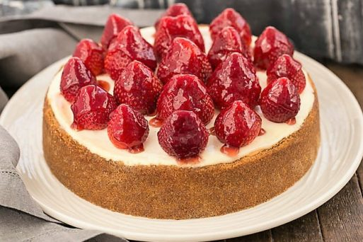 Strawberry Topped Cheesecake on a white ceramic serving plate