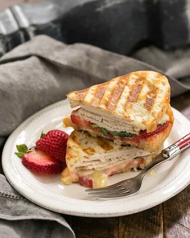 Side view of a stacked Strawberry, Turkey and Brie Grilled Cheese
