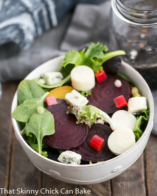 Beet Salad with Blue Cheese and Hearts of Palm in a white ceramic bowl