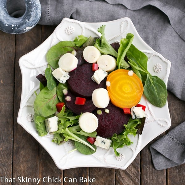 Beet Salad with Blue Cheese and Hearts of Palm on a six sided white salad plate