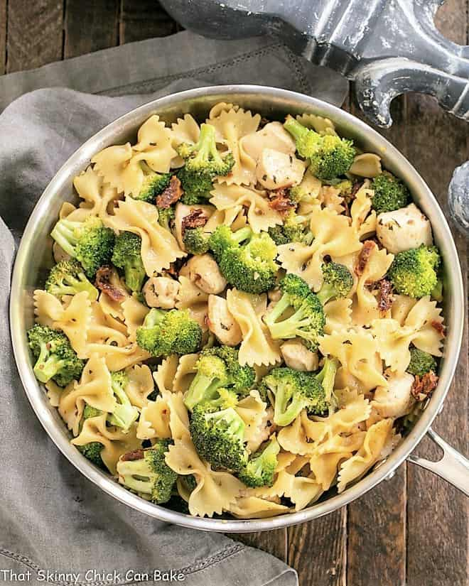Overhead view of Chicken with Broccoli and Pasta in a saute pan