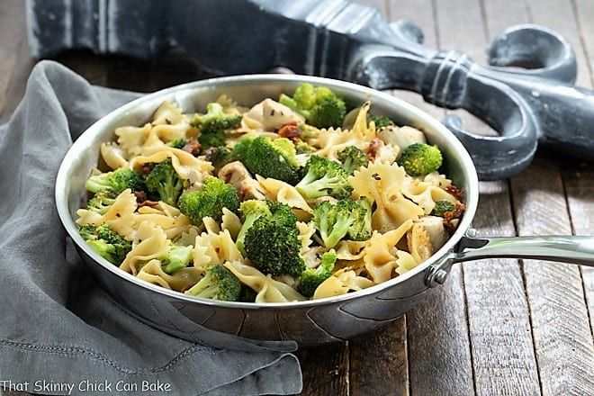 Chicken Broccoli Sun-dried tomato Pasta in a stainless steel frying pan