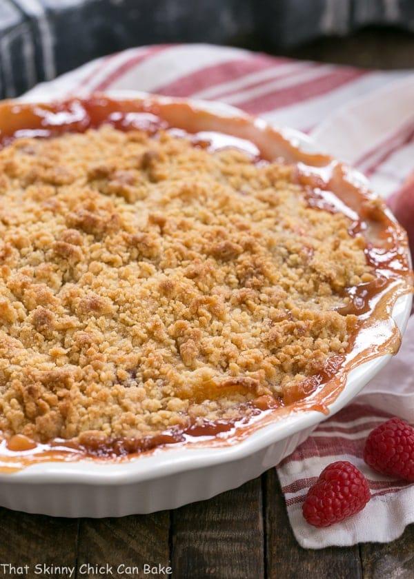 Peach Raspberry Crisp in a white porcelain pie plate