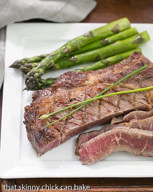 Sliced Perfect Grilled Rib Eye Steaks on a square white plate