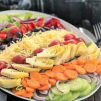 Kitchen Sink Chopped Salad on a white ceramic platter