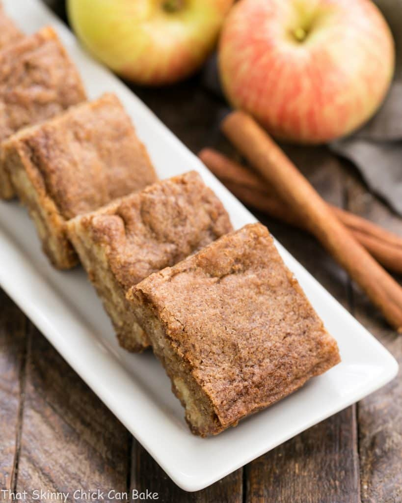 Apple Brownies squares on a white ceramic platter